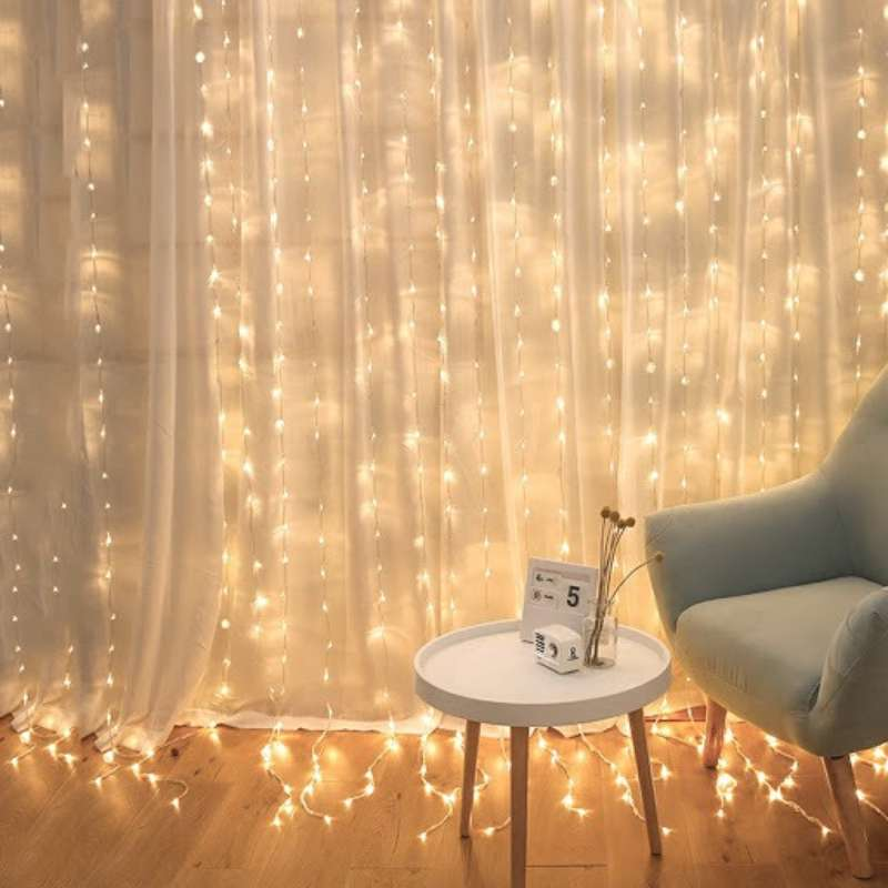 Starlit Curtain hung on the window curtain beside nordic coffee table and sofa