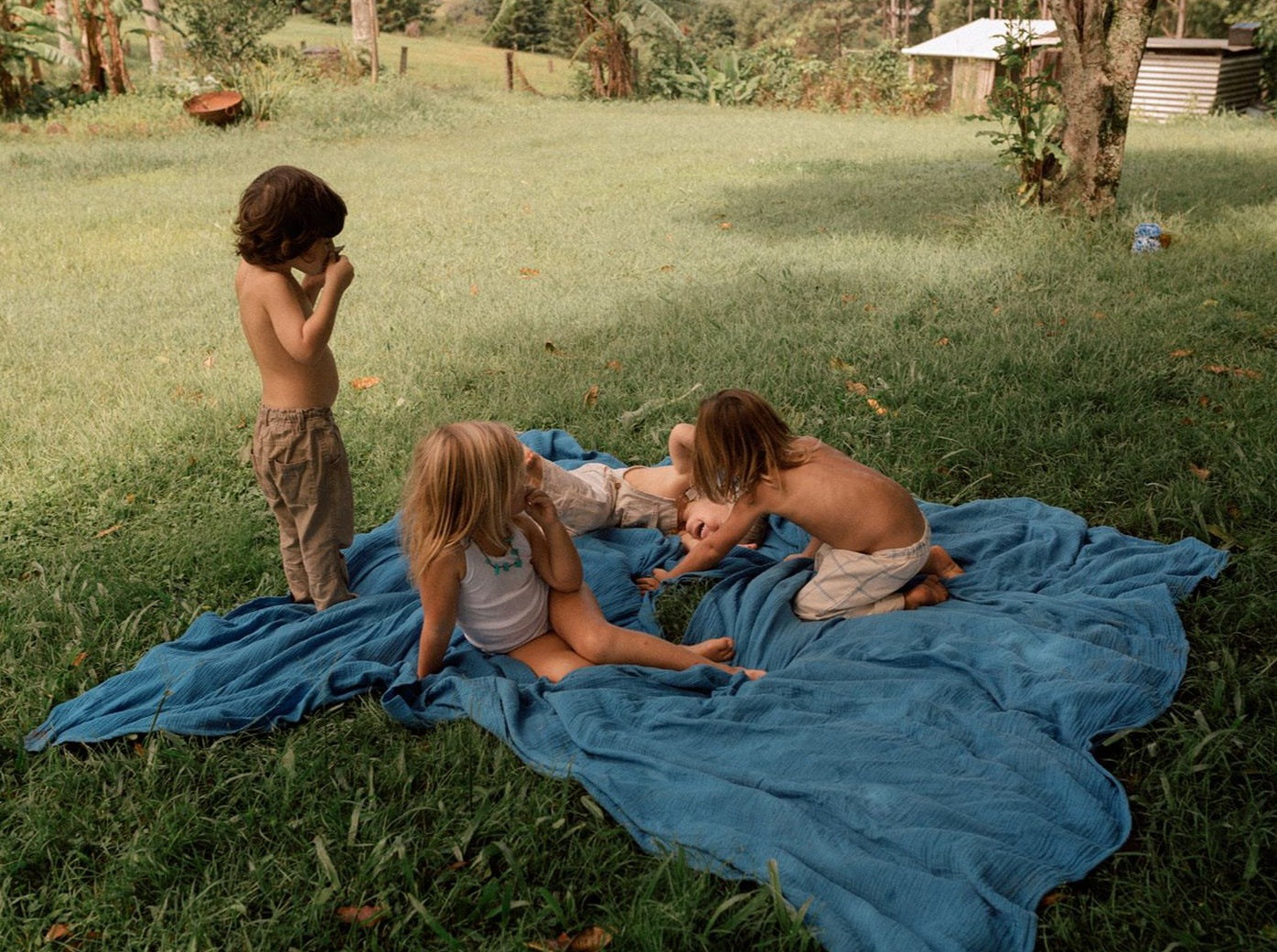 children playing on taninaka's life wrap - extra large muslin wrap - soft and durable in organic cotton and dyed with eco dyes