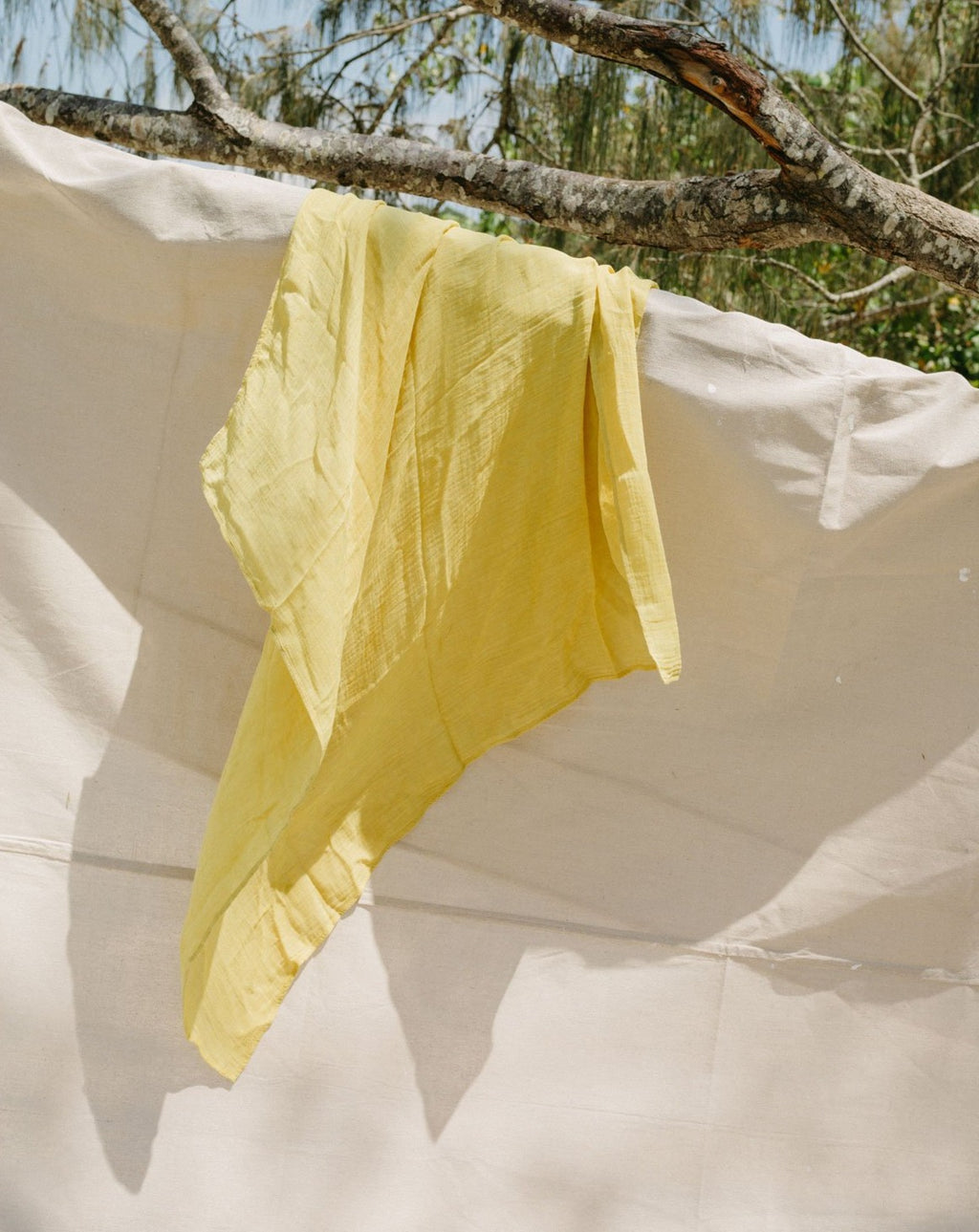 plant dyed lemon earth wrap hanging - summer swaddle wraps -swaddling in summer - swaddle muslin wrap - baby swaddle - baby wrapping - swaddle wrap - baby muslin wrap - newborn swaddle