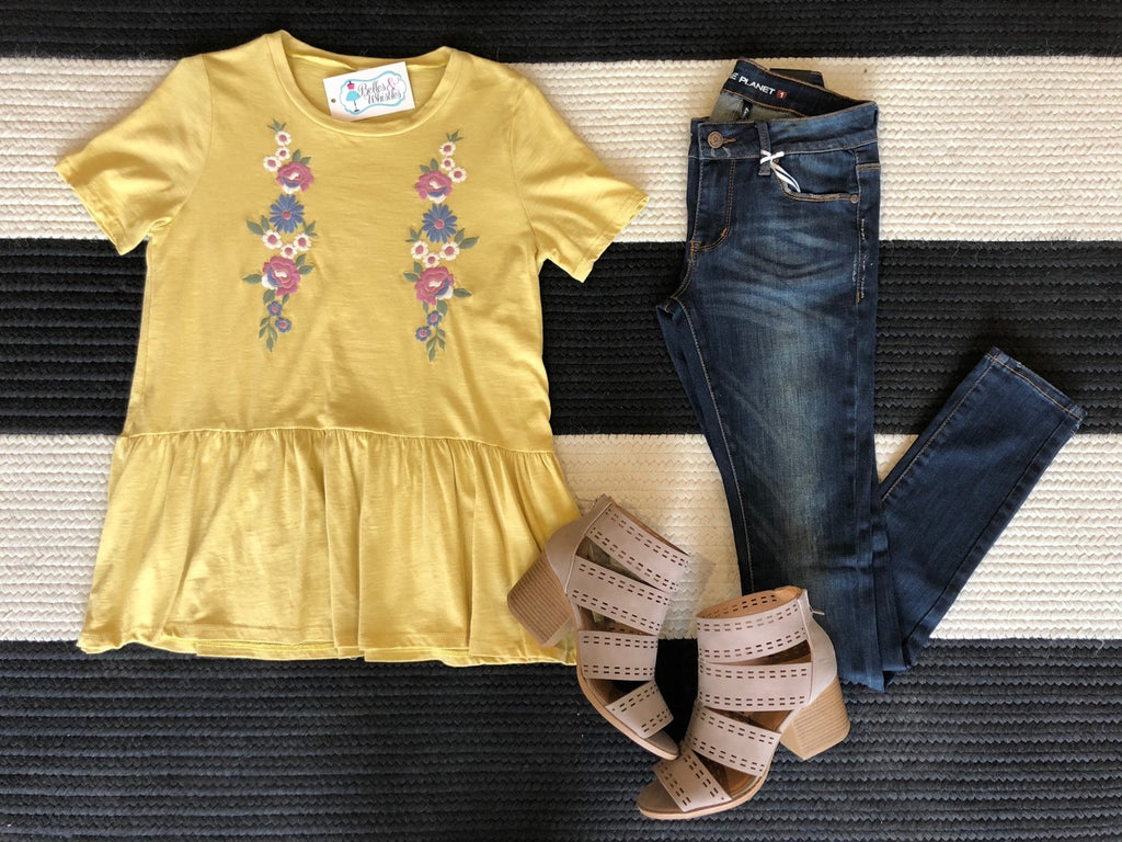 All Smiles Peplum Top