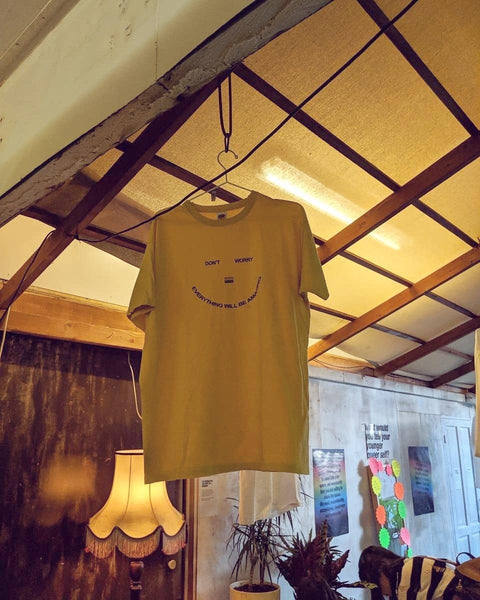 'Don't worry everything will be amazing' smiley Pride T-shirt on display