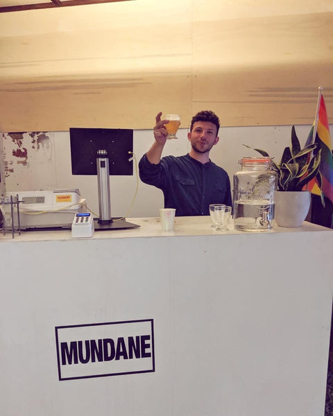 Bartender behind the bar at the Queer T-Shirts exhibition and zine launch