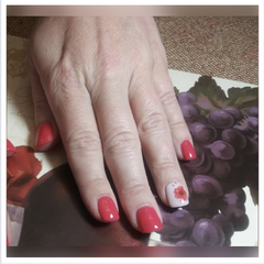 Photo of a dip powder manicure with D250 Muse and D74 Veronica Revel Nail