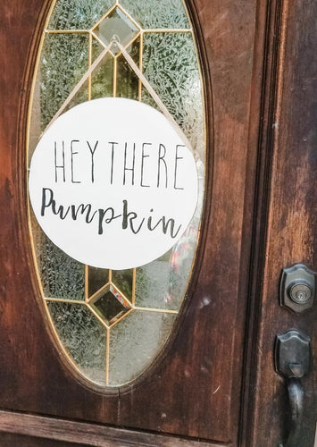 Our Hey There Pumpkin Sign will complete your outdoor fall decor in 2020. This aesthetic door hanger with a cheeky quote about fall adds a cozy touch to your front porch that is perfect for Autumn. This modern sign's simple design makes it versatile. Enjoy a cup of coffee in a cozy outfit on your couch, bask in the warmth coming from your fireplace and soak up the vibes while you enjoy this fall wood sign on your mantle. #falldecor #homedecor #porchdecorations