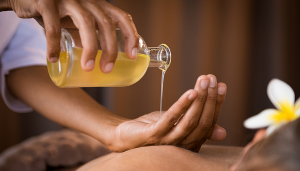 woman-pouring-massage-oil-into-hands-to-improve-circulation-in-the-body-as-part-of-soffli-holistic-skincare-habits-and-rituals