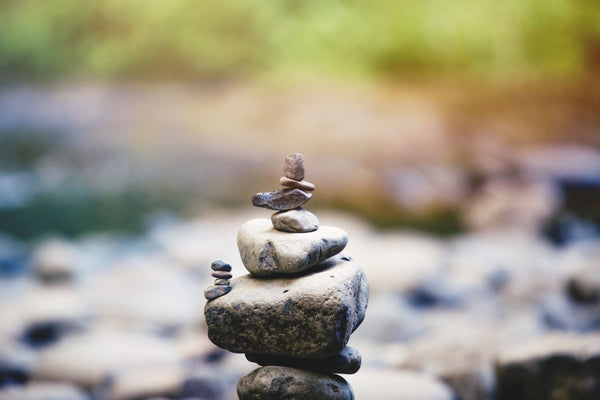 various stacked stones symbolizing the importance of balance in battling skin infections as part of K-beauty influenced holistic skincare habits and tips