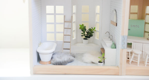 beautiful dollhouse bathroom with tub, sink, fuzzy rugs, plants, etc. symbolizing the importance of a beautiful bathroom for good skincare habits as part of K-beauty influenced holistic skincare habits and rituals