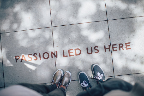 """passion led us here"" sign symbolizing the importance of setting core values for a purposeful life as part of K-beauty influenced holistic skincare habits and rituals"