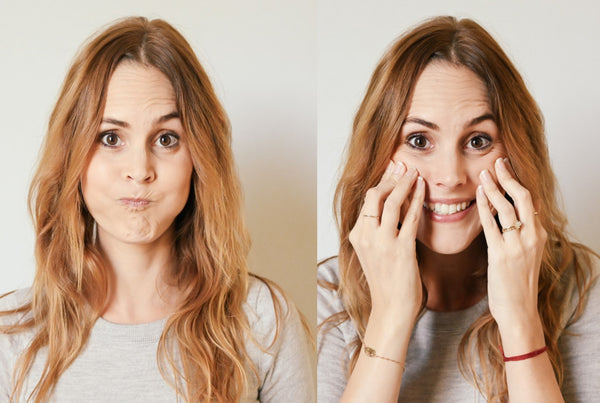 Woman doing face yoga poses exercising and working out her face which causes wrinkles and is discouraged under K-beauty influenced holistic skincare habits