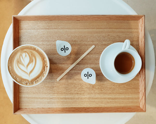coffee-with-percentages-displayed-on-wooden-tray-symbolizing-why-higher-percentages-aren't-better-in-skincare-products-as-part-of-soffli-minimal-skincare-approach