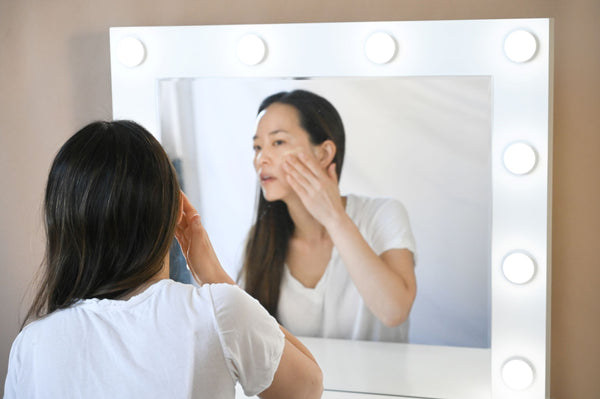 Minji-from-Soffli-applying-Soffli-skincare-products-to-face-at-vanity-and-discussing-how-COVID-19-changed-skincare-in-2020