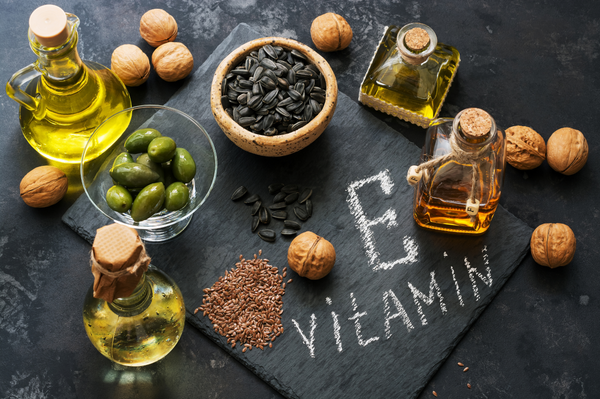 walnuts, seeds and olives which have high amounts of vitamin e displayed to highlight this key skincare ingredient as part of soffli clean skincare