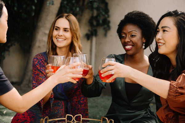 three-women-drinking-summer-drink-symbolizing-the-importance-of-adjusting-your-skincare-routine-for-summer-as-part-of-K-beauty-influenced-holistic-skincare-habits-and-rituals