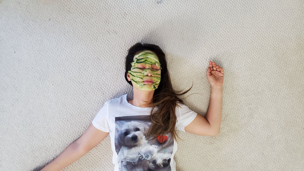 asian-woman-with-cucumber-peels-all-over-her-face-engaging-in-the-K-beauty-cucumber-massage