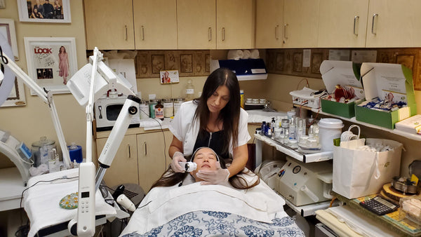 woman getting facial from skincare expert Ronit in beverly hills as part of K-beauty influenced holistic skincare habits