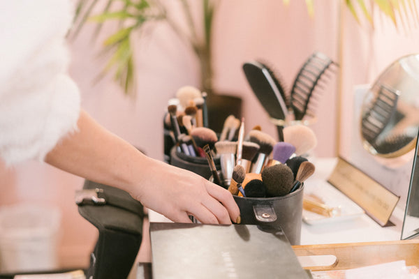 makeup brushes displayed on beauty counter symbolizing the importance of spring cleaning your makeup brushes and beauty tools as part of K-beauty influenced holistic skincare habits and rituals
