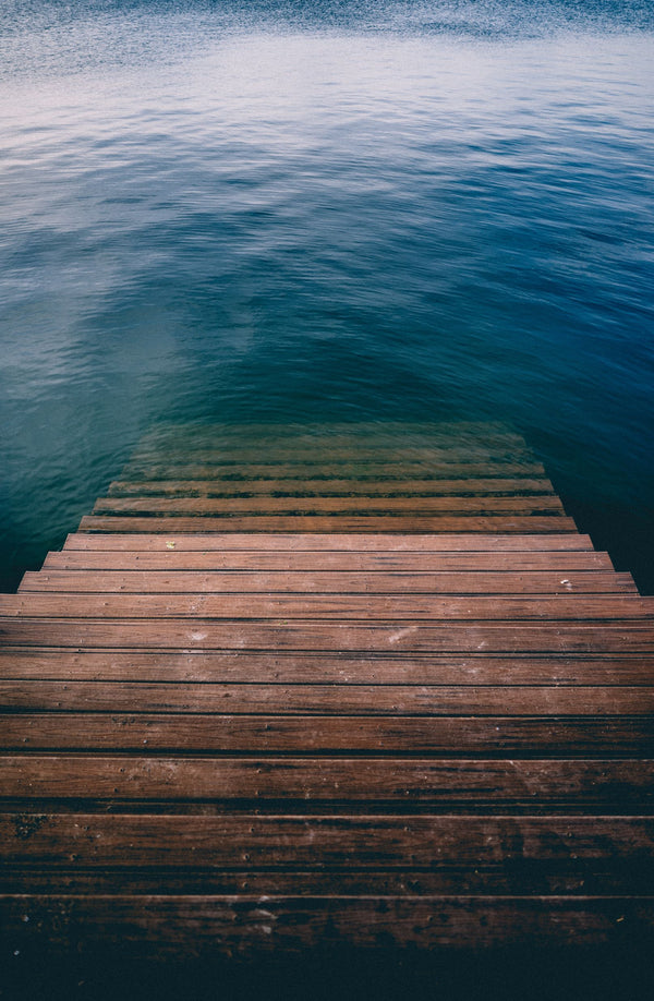 wooden steps going into water symbolizing K-beauty influenced holistic skincare 6-step morning routine
