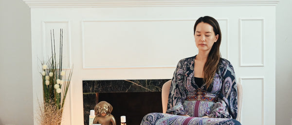 Minji-Founder-of-SOFFLI-minimalist-skincare-meditating-on-self-to-alleviate-stress-as-part-of-holistic-skincare-rituals-and-habits