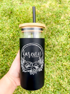 Glass tumbler with engraved silicone sleeve
