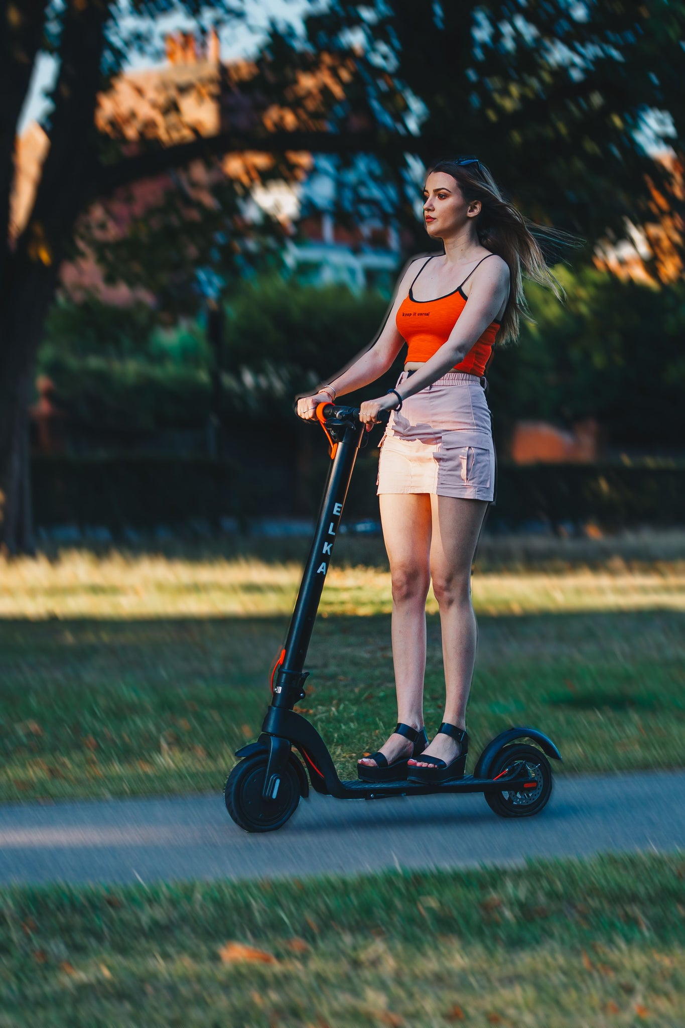 girl riding scooter in park
