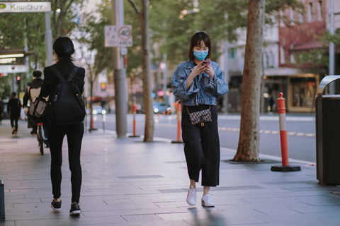person walking with mask