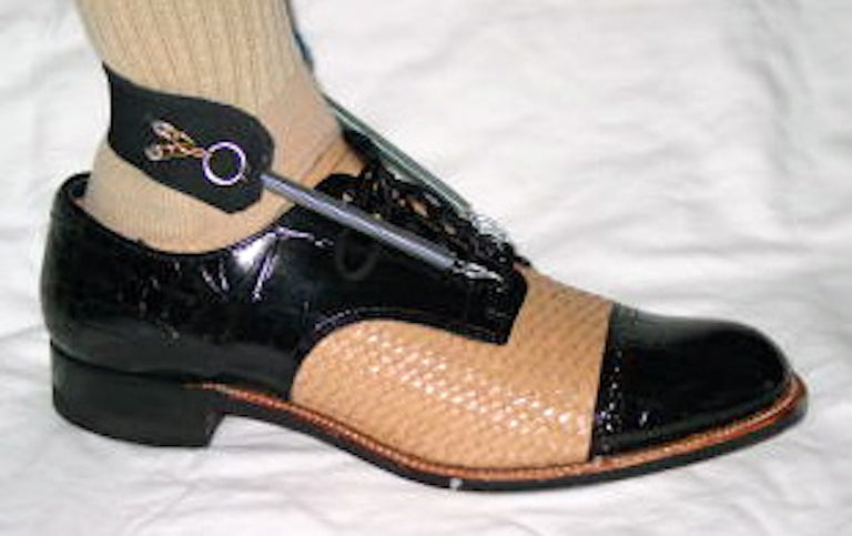 Chris wearing Freedom Walk AFO Free Flex Drop Foot Brace with a black and beige dress shoe