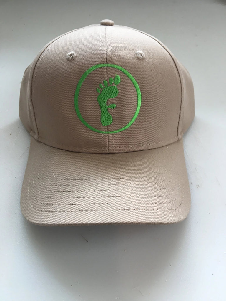Freedom Walk AFO Free Flex Logo on beige baseball style hat and green logo of a foot in the shape of the letter F