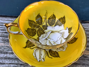 Vintage Paragon Yellow w/ White Flowers and Gold Trim Tea Cup and Saucer
