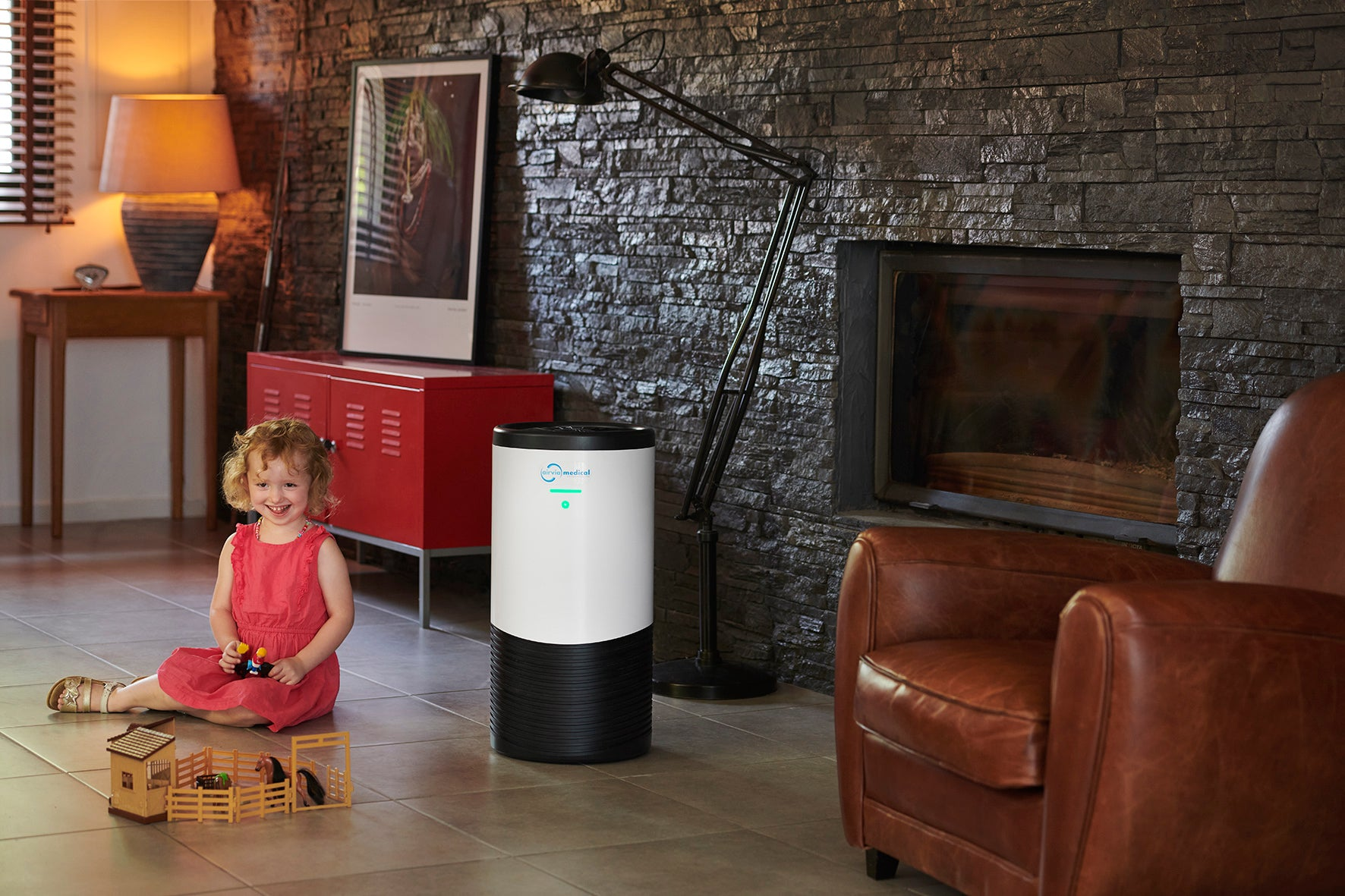 AIRVIA AERO 100 air purifier in a living room
