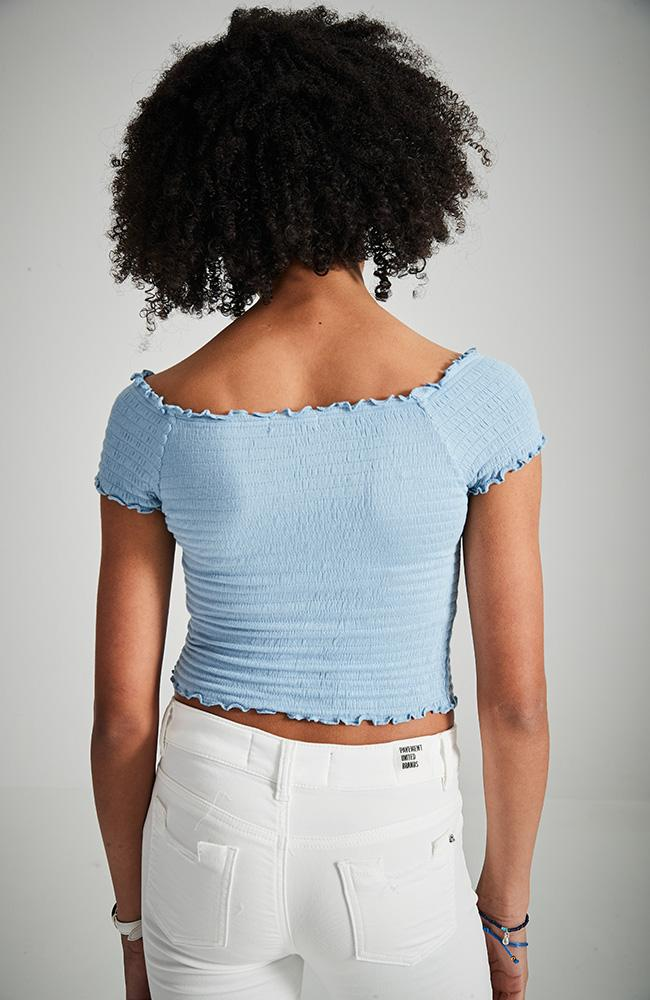 selena blue shirred ruffle short sleeve slightly cropped girls top