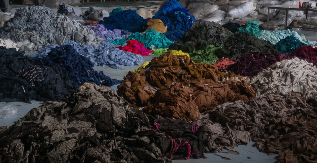 fabric remnants leftover at an abandoned factory in Cambodia