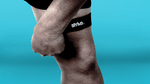 Use Strive's Patella Support Strap above knee