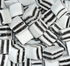 Black and white mints with refreshing minty and liquorice taste