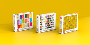 LEGO Puzzle boxes on yellow background