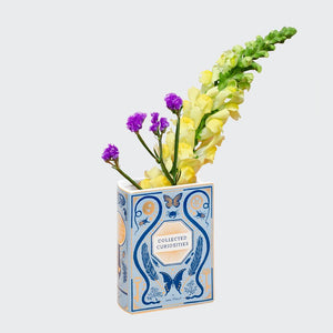 Bibliophile Ceramic Vase: Collected Curiosities with yellow and purple flowers