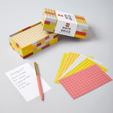 LEGO Note Brick (Yellow-Orange) with open box and fanned our note sheets