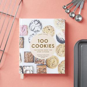 100 Cookies: The Baking Book for Every Kitchen with sheet pan, measuring spoons and cooling rack