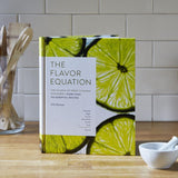 The Flavor Equation cover with kitchen utensils