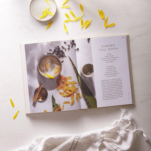 Moon Bath, Bathing Rituals and Recipes for Relaxation and Vitality interior with towel and flower petals