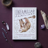 Unfamiliar Familiars cover with crystals, flowers and natural items