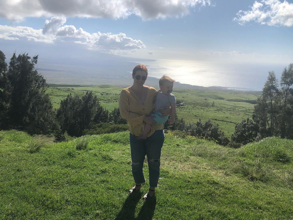 Mother and son posing on hillside