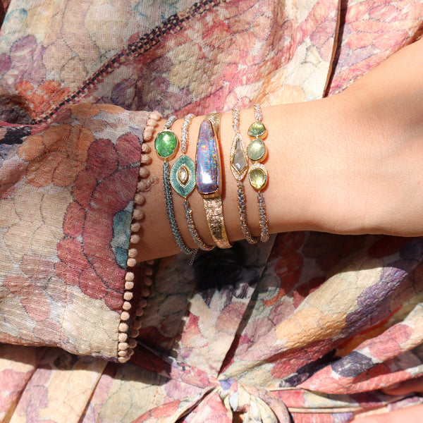 Model Wearing Hand made in London Brooke Gregson 18k Gold Diamond Enamel Talisman Eye with Hand Woven Silk Chain Bracelet