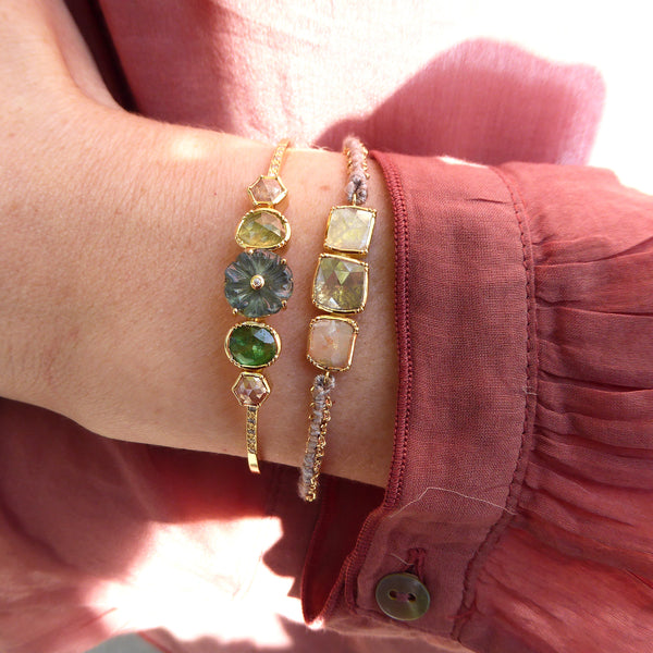 Model wearing Hand made in London Brooke Gregson 18k gold Diamond Emerald and Carved Aquamarine Flower Cuff