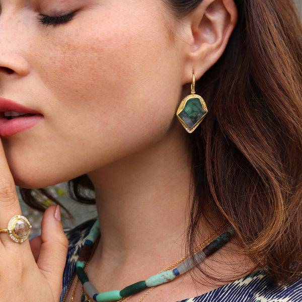 Model wearing Hand made in London Brooke Gregson 18k gold raw Emerald Diamond Earrings
