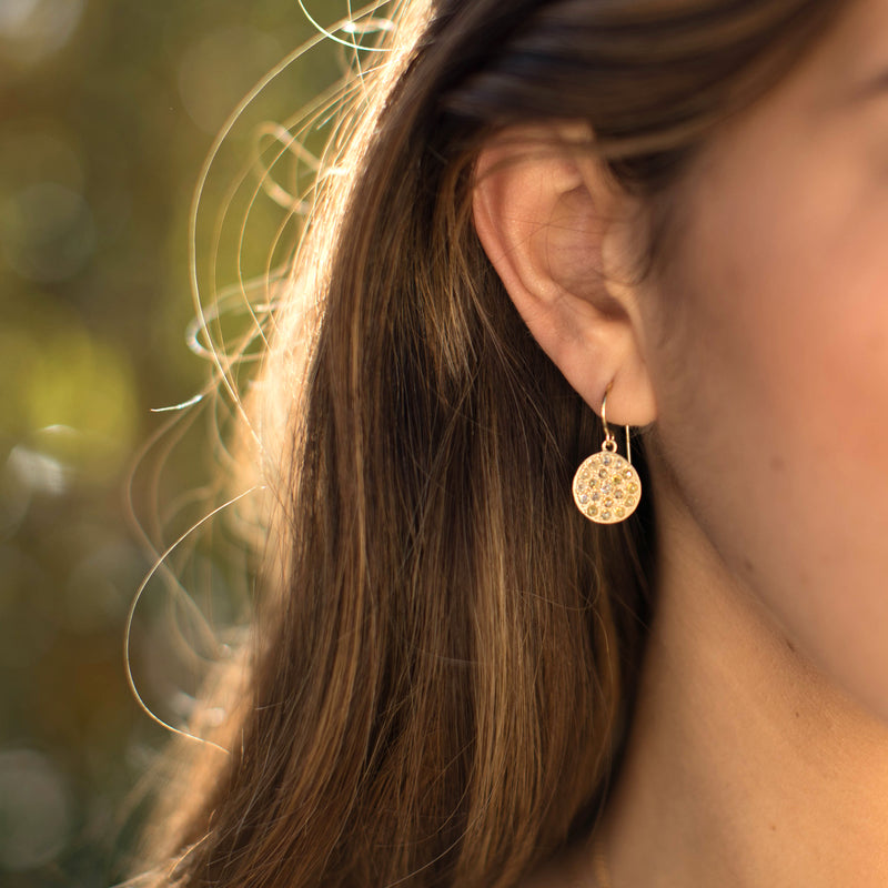 Model wearing Hand made in Los Angeles Brooke Gregson 14k textured gold mixed color rose cut diamond earrings