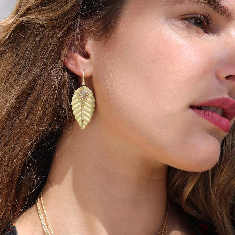 Model wearing Hand made in London Brooke Gregson 18k gold Carved Leaf Diamond Earrings