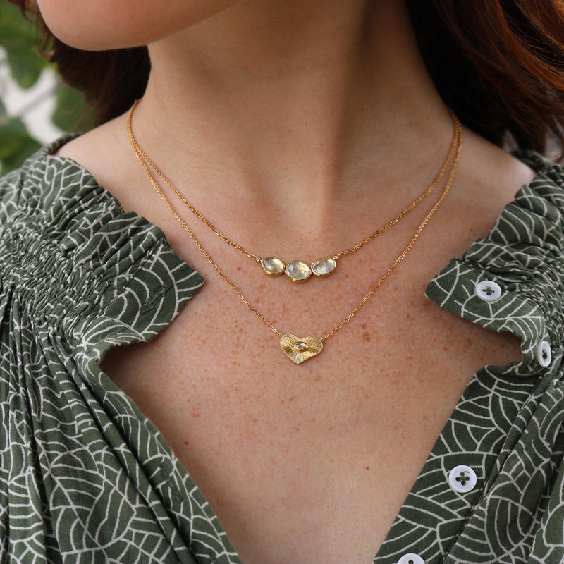 Model wearing Hand made in London Brooke Gregson 18k gold engraved heart diamond necklace