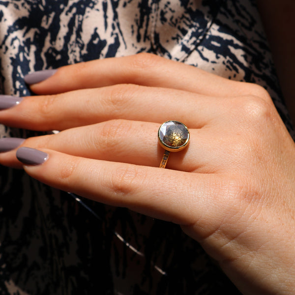 Modeal wearing Hand made in London Brooke Gregson 18k gold raw diamond Ring
