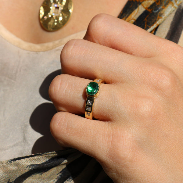 Model wearing Hand made in London Brooke Gregson 18k gold diamond Emerald Wedding Band Ring