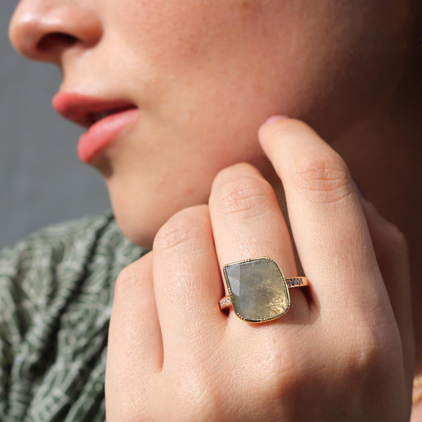Model wearing Hand made in London Brooke Gregson 18k gold raw diamond Ring with diamond band